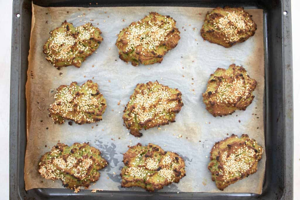 falafel on a baking sheet after coming out of the oven