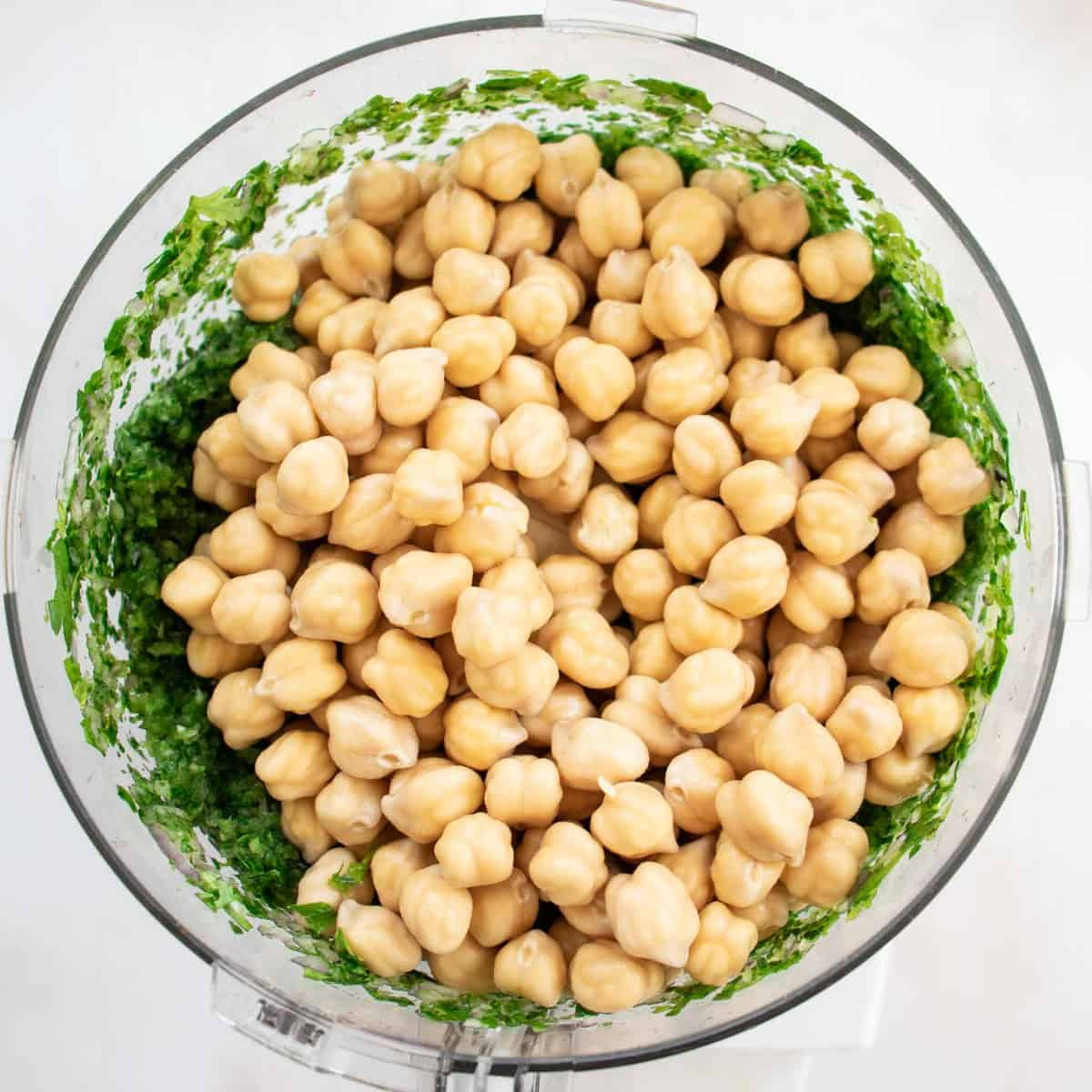 add the soaked chickpeas to the food processor