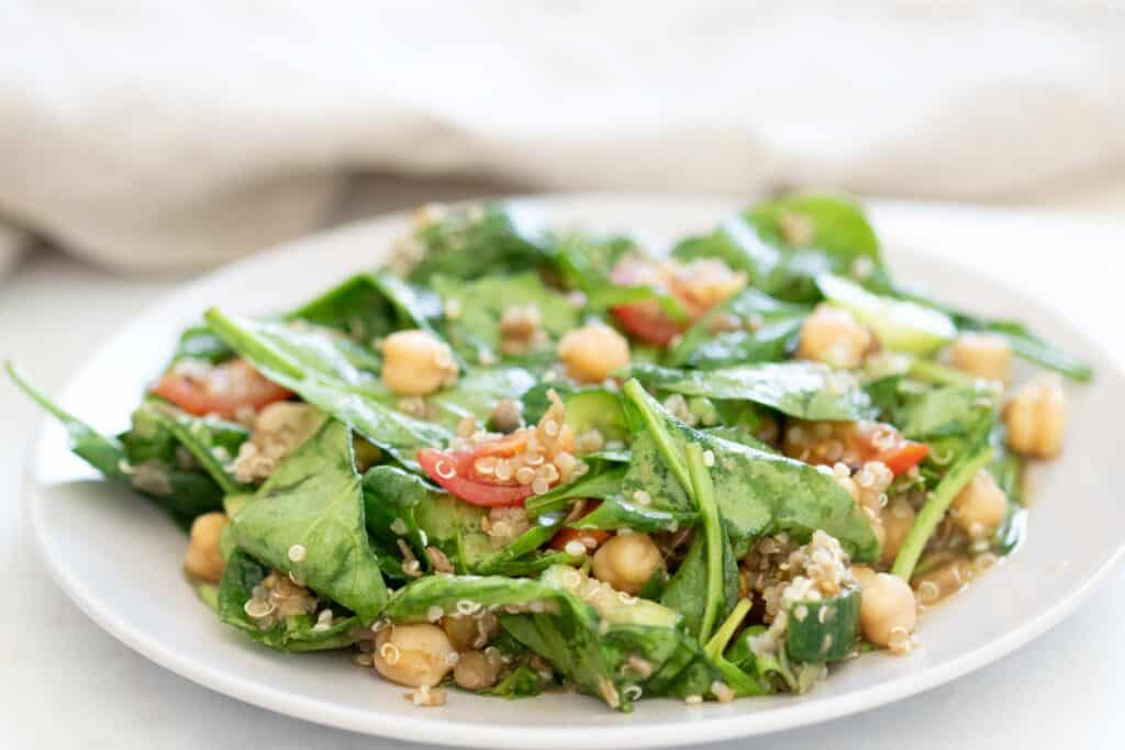 quinoa and spinach salad on plate