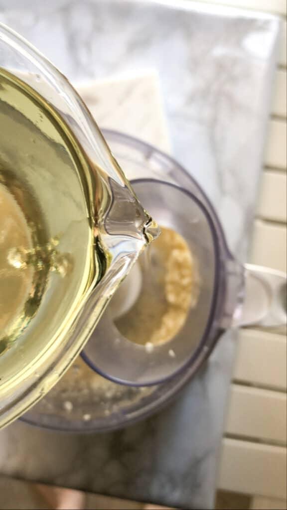 Pour oil in lebanese garlic sauce