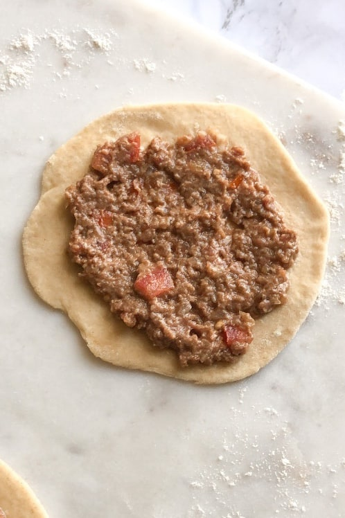 sfiha meat mixture on dough