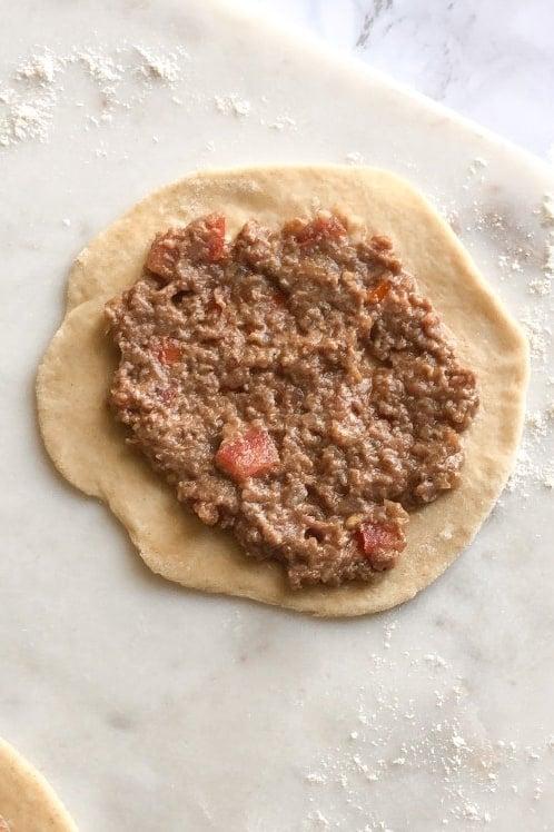sfiha meat mixture on dough