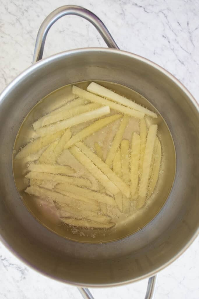 homemade french fries that are fried