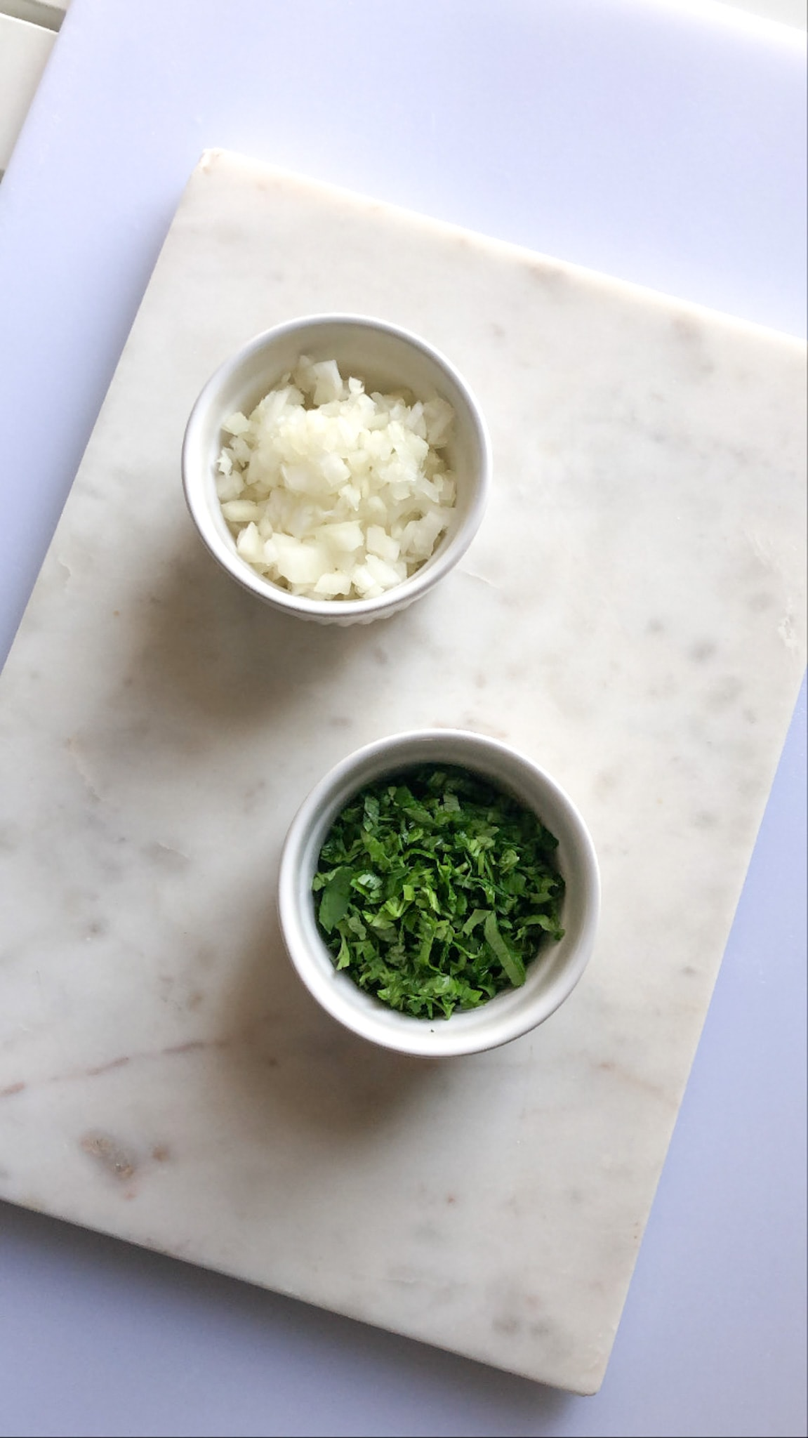 chopped onions and parsley in a bowl