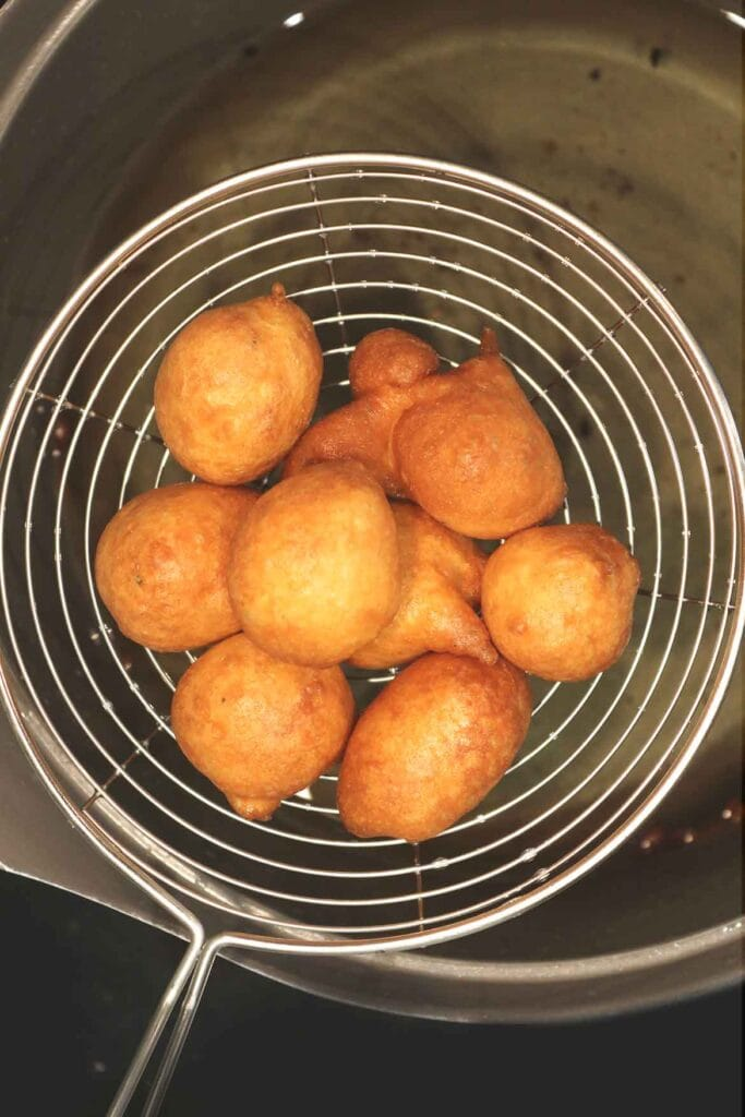 fried dough balls strained from the hot oil