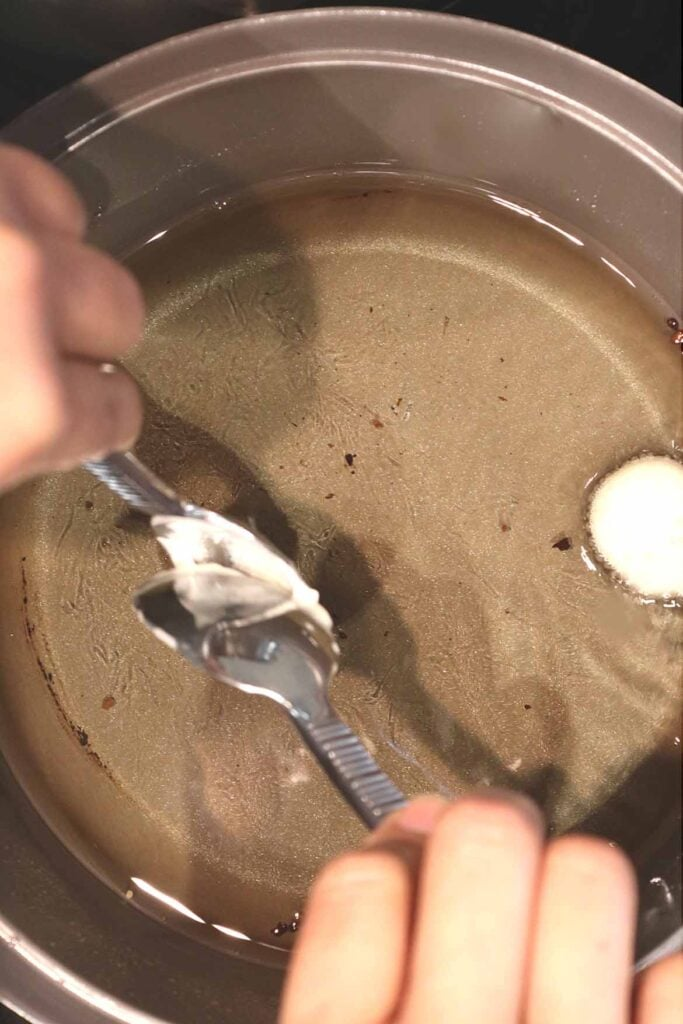 how to drop the loukoumades batter into the hot oil