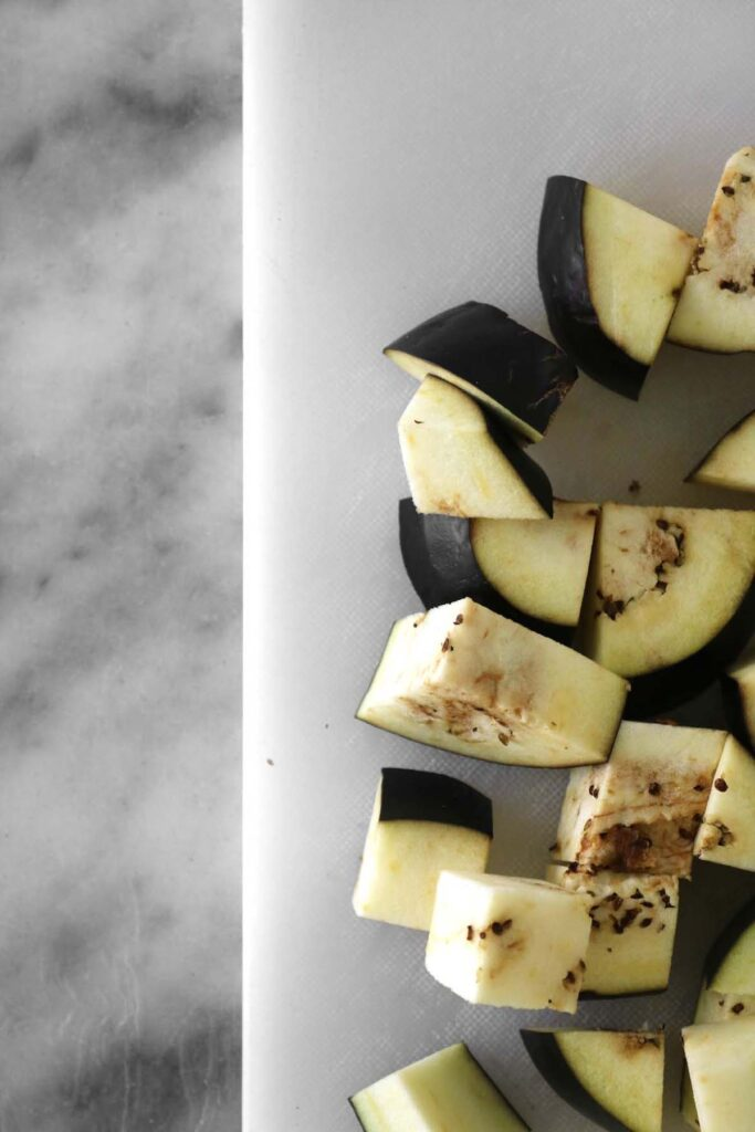 chopped eggplant cubes close up on a plate