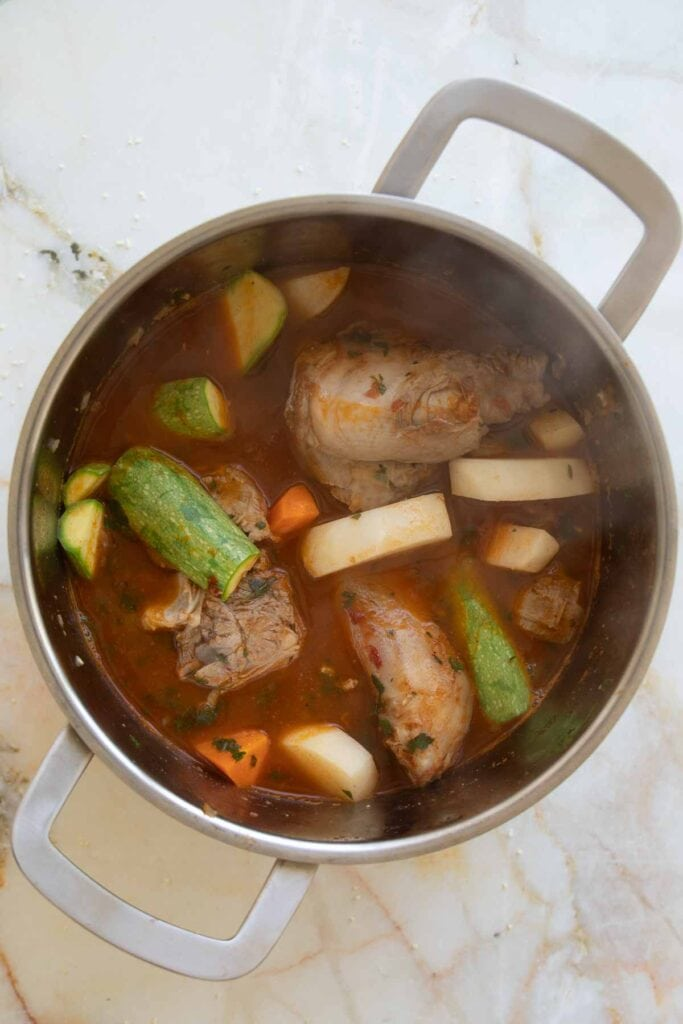 lamb stew in a pot getting ready to simmer