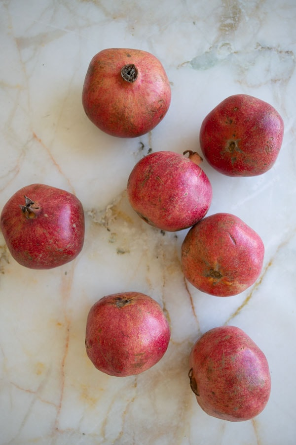 whole pomegranates on top of a counter