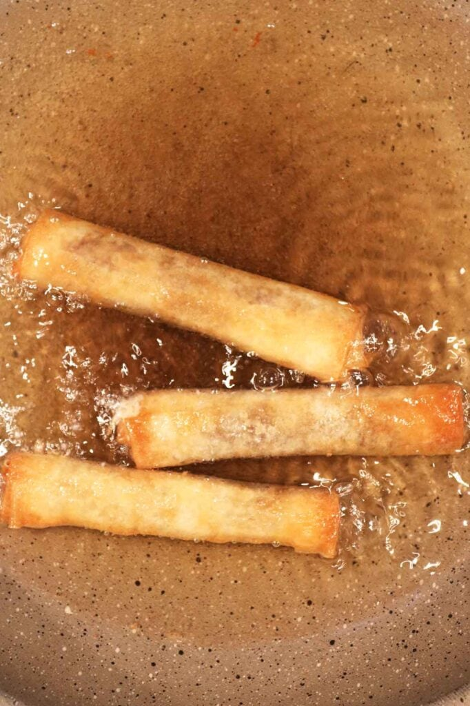 frying the spring rolls