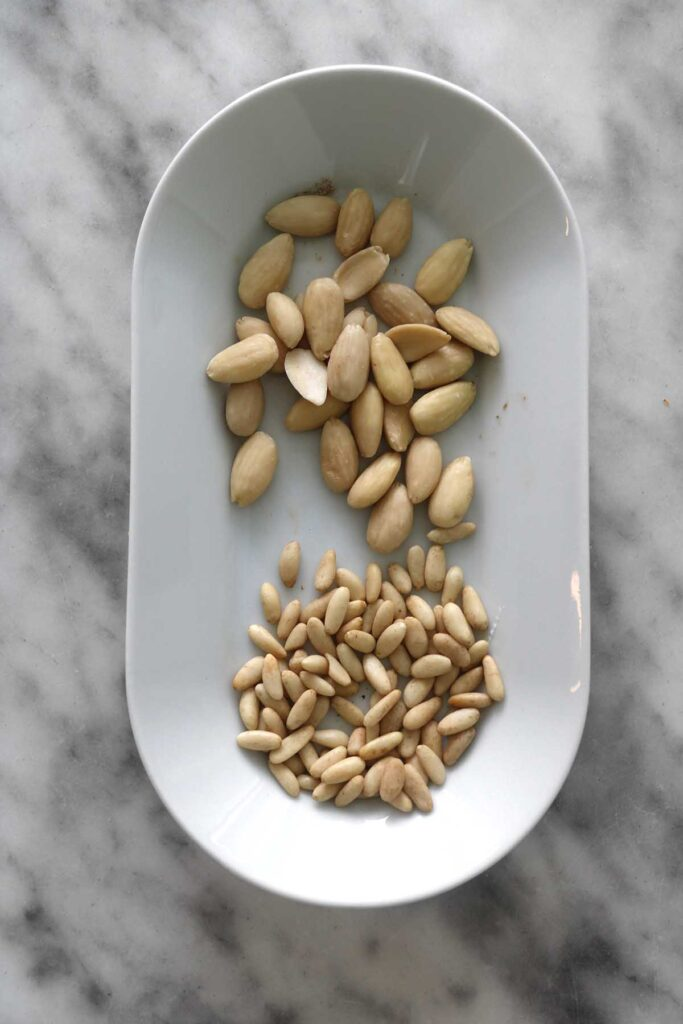 almonds and pine nuts on a plate