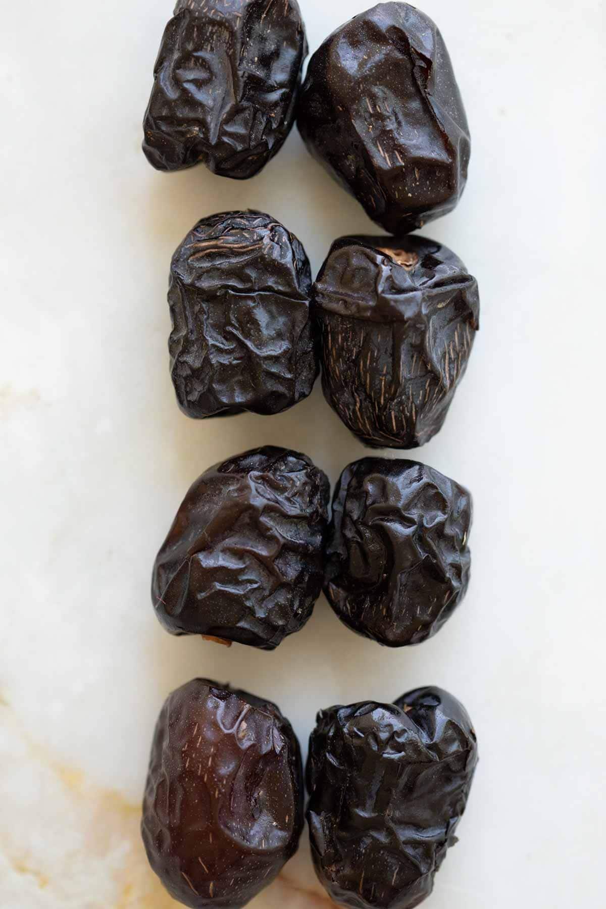 ajwa dates in a line