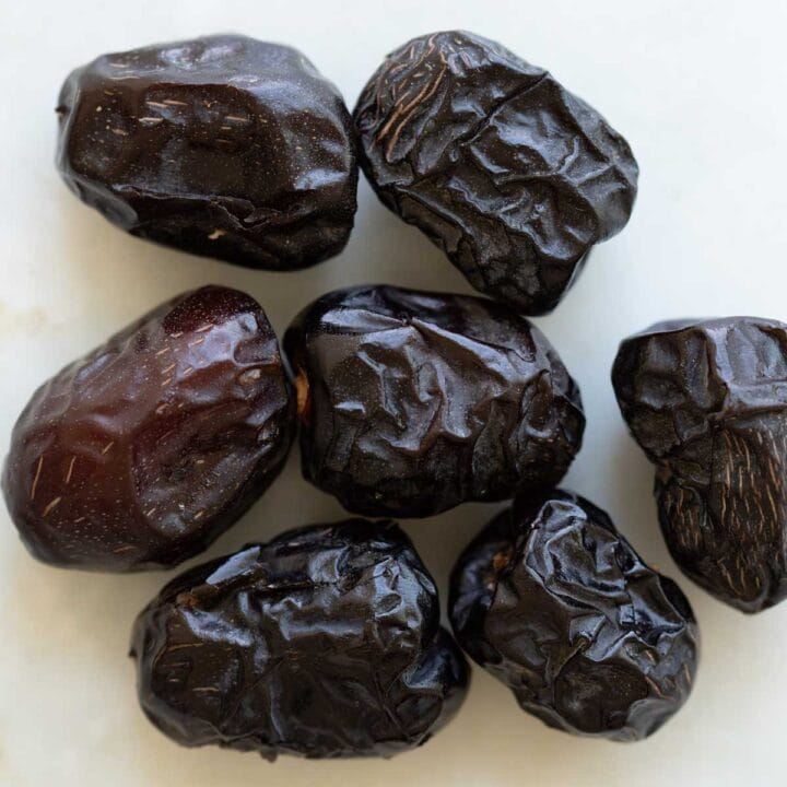 ajwa dates on a table