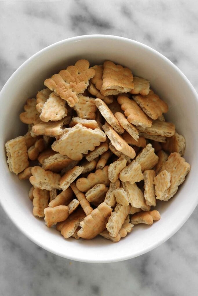 biscuit crackers broken into pieces in a bowl