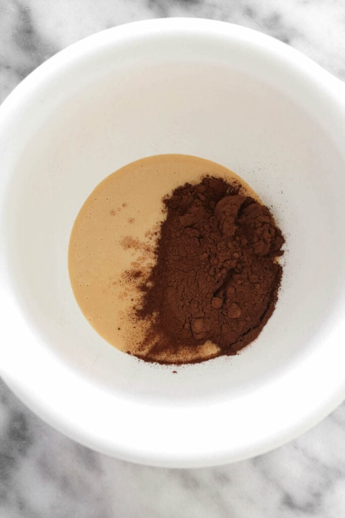 cocoa powder and condensed milk in a bowl