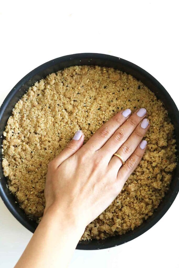 pressing the date mixture into the cake pan