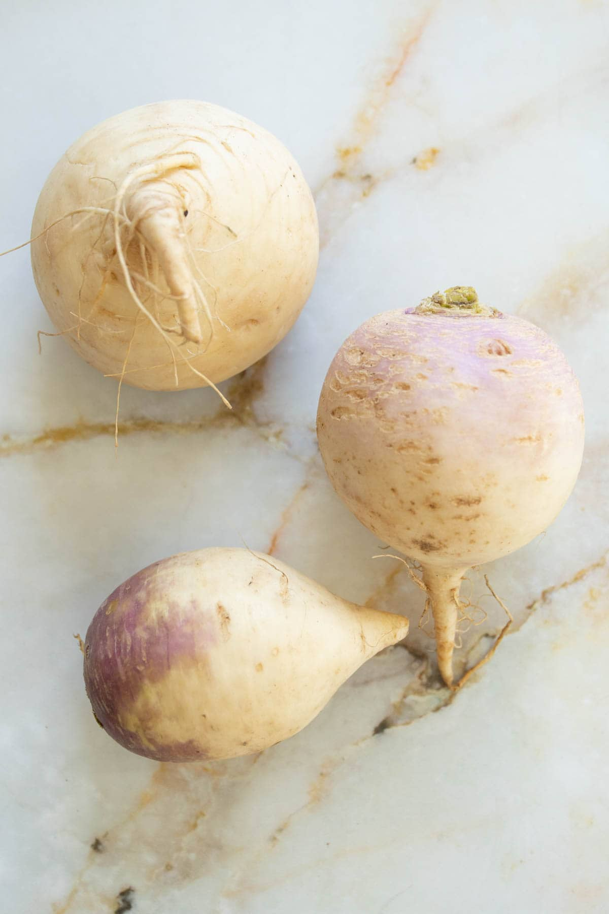 whole turnips on the counter