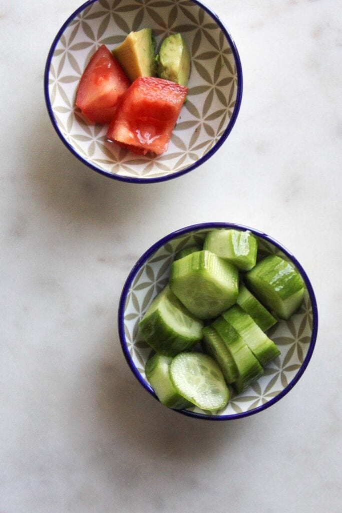 sliced cucumbers and tomatoes in a bowl
