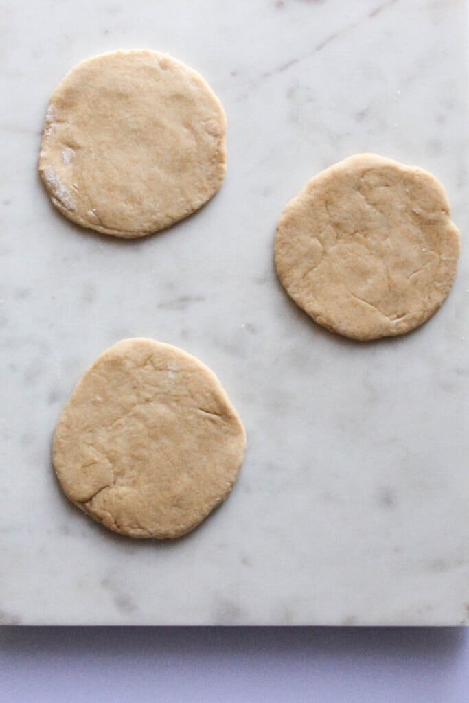 manakeesh dough that's been rolled flat