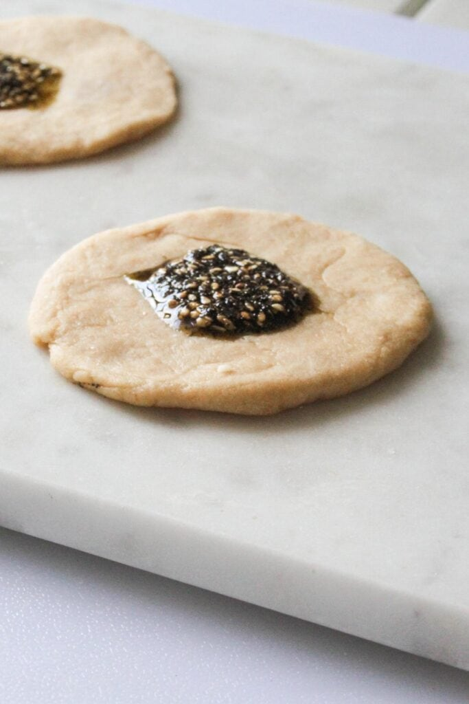zaatar olive oil mixture on top of the dough