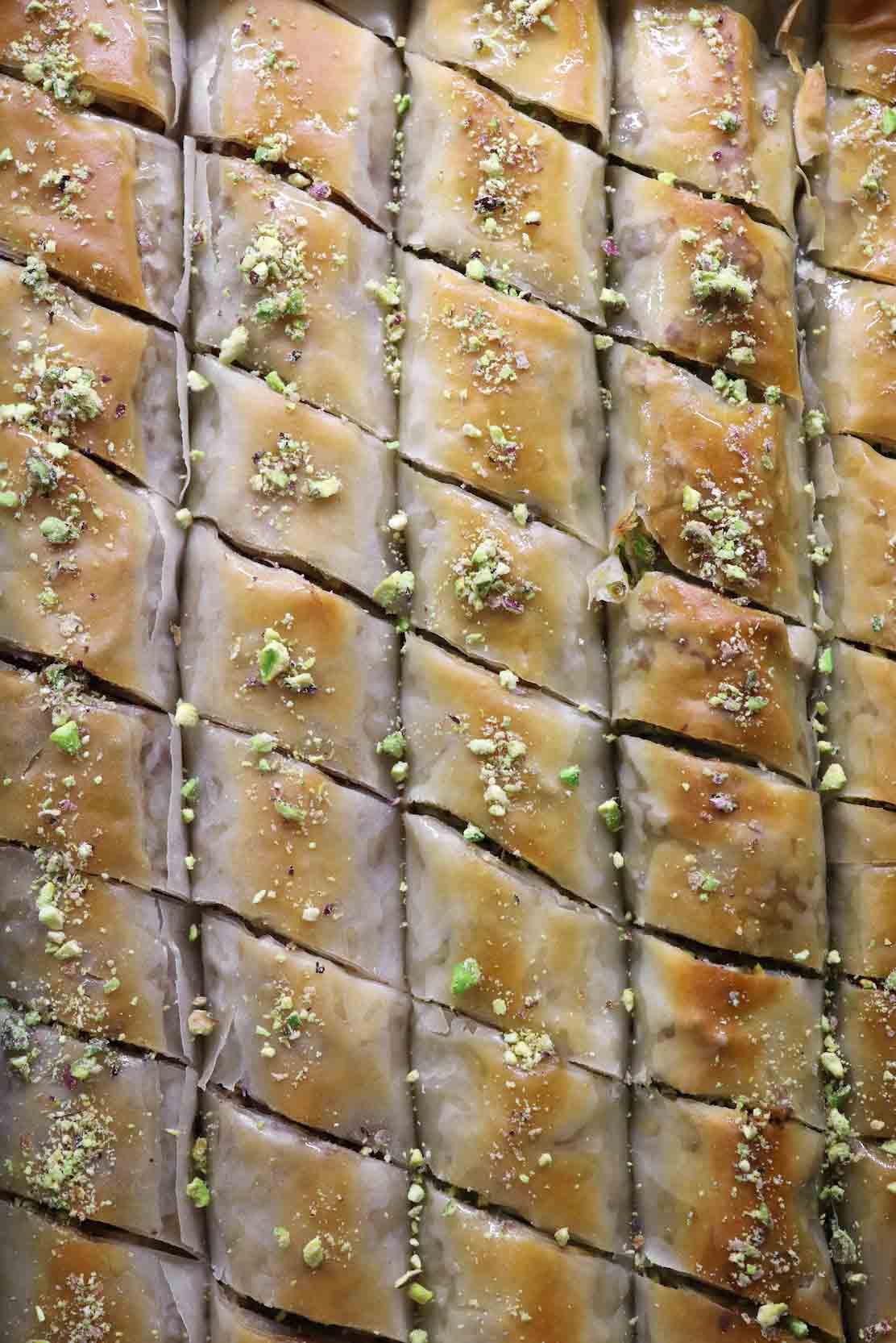 sheet pan of baked baklava rolls