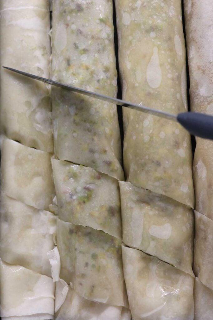 cutting the baklava rolls