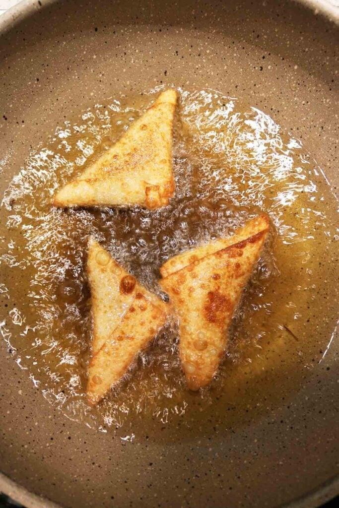 frying the beef samosas