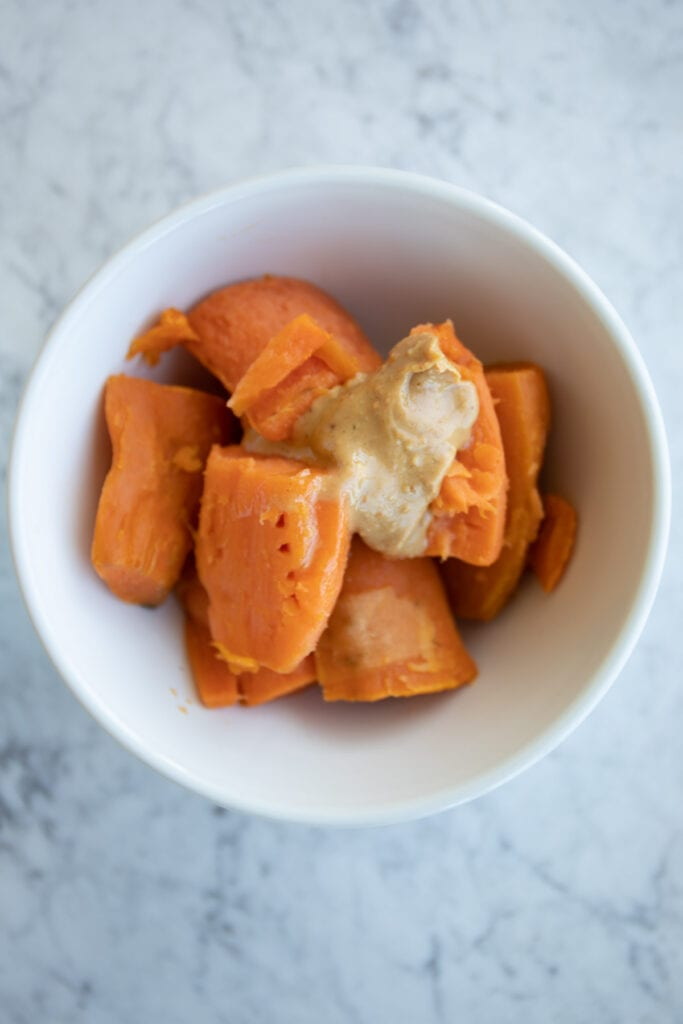 sweet potatoes with almond butter in a bowl