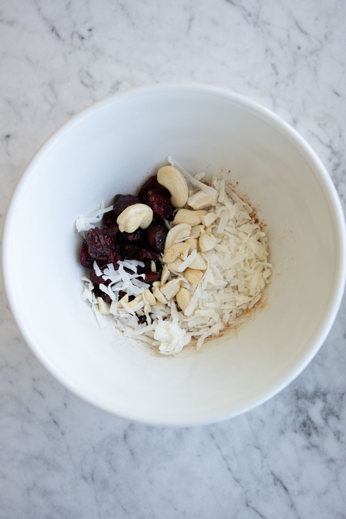 cashews, cranberries, and shredded coconut in a bowl