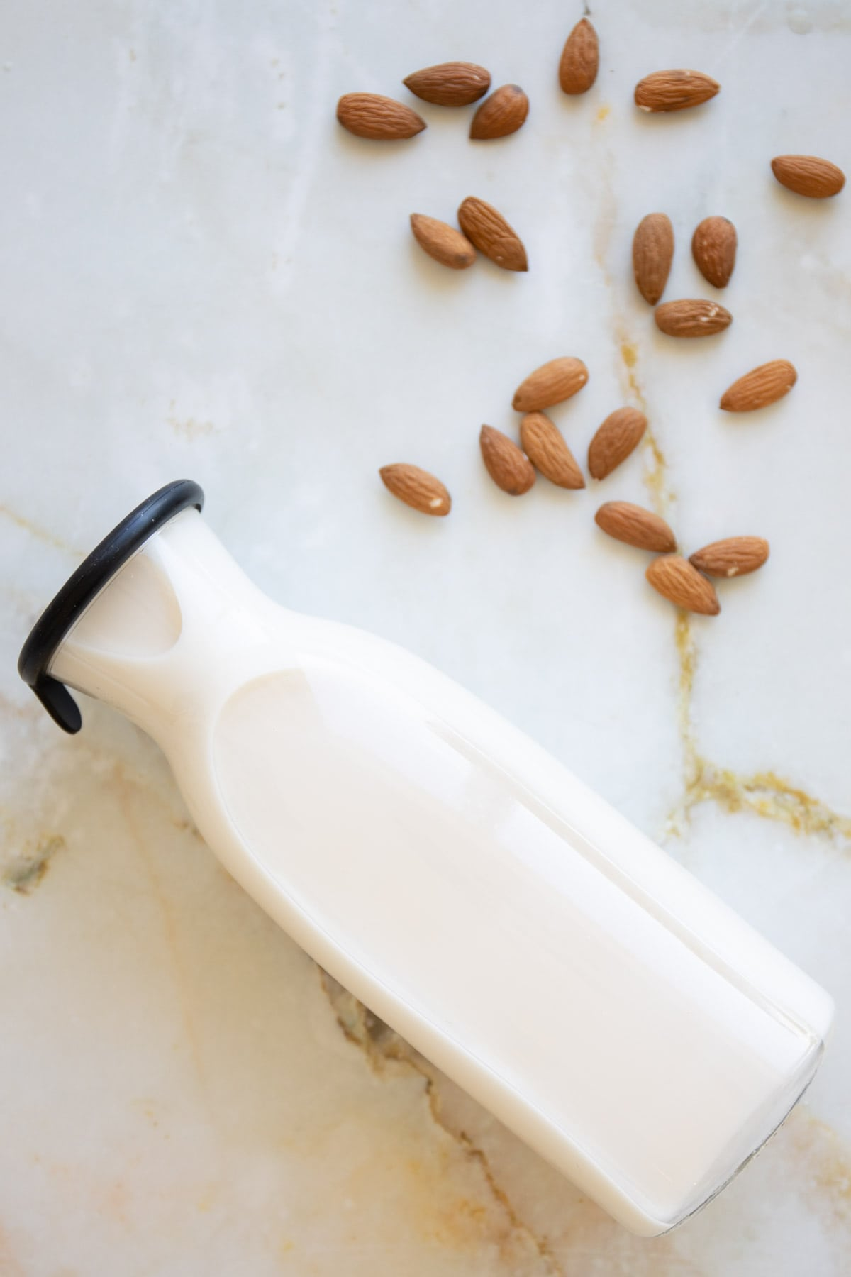 almond milk in a glass container