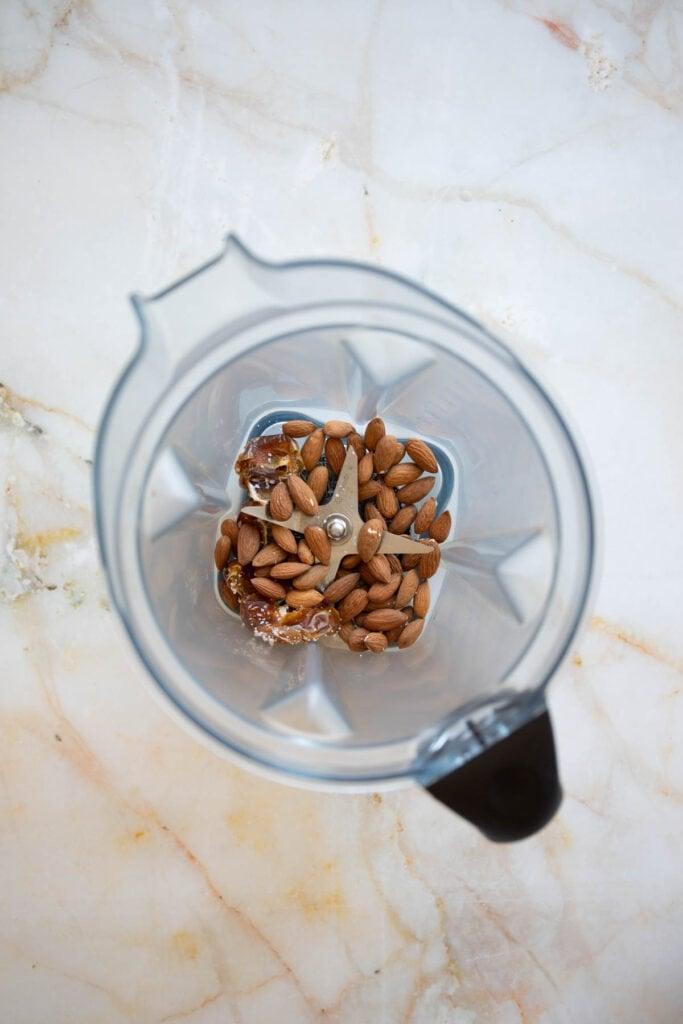 almonds, dates, and sea salt in a vitamix blender