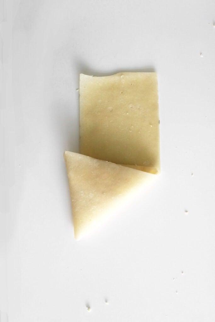 folding the samosa into a triangle