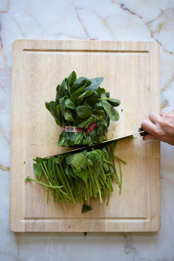 chop the stems of the spinach