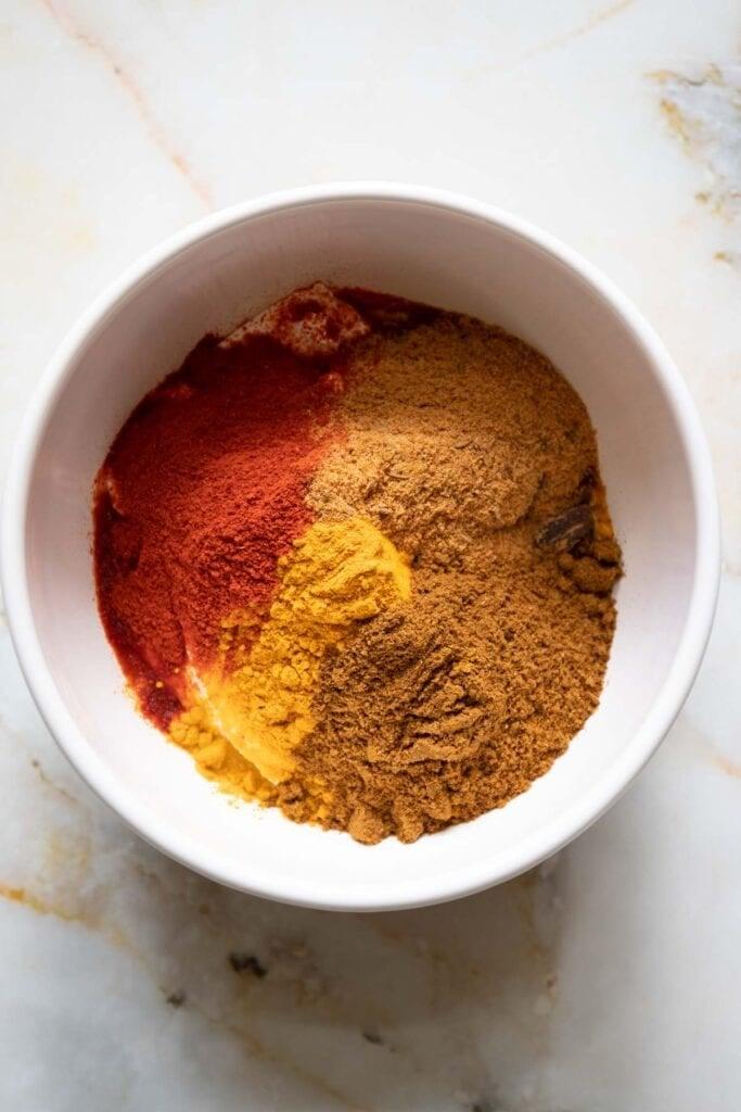 chicken biryani marinade ingredients in a bowl