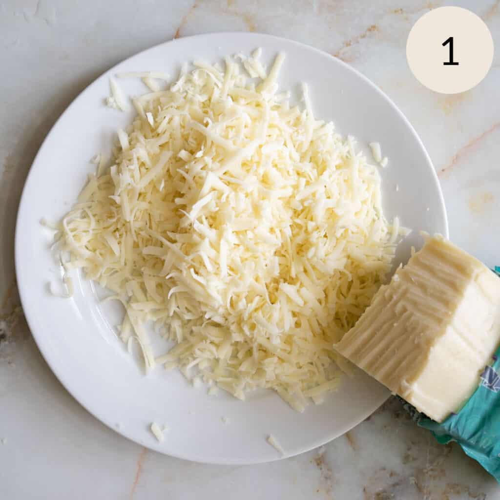 Shredding a block of mozzarella cheese