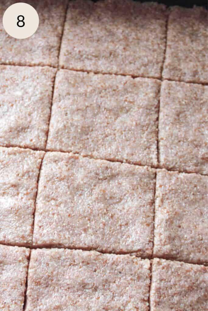 slicing the kibbeh into diamond squares