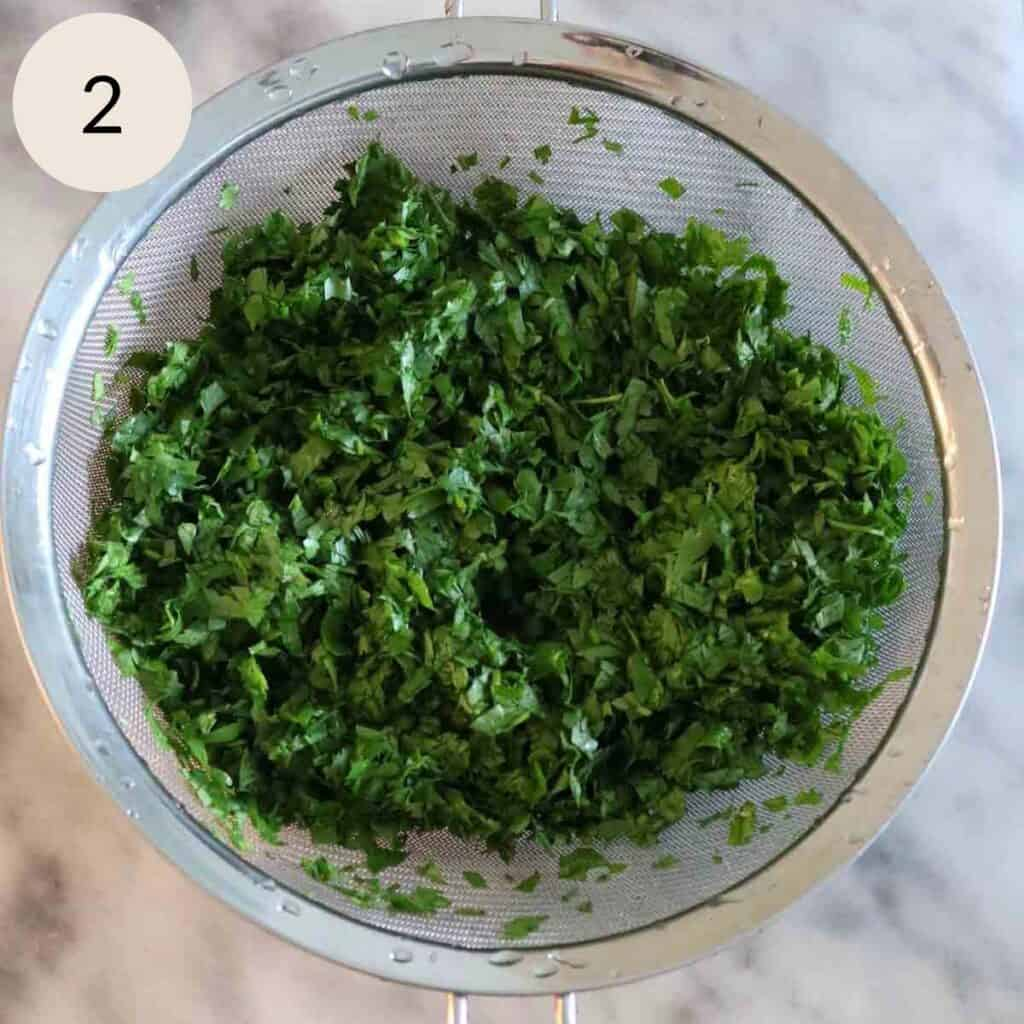 chopped parsley in a strainer