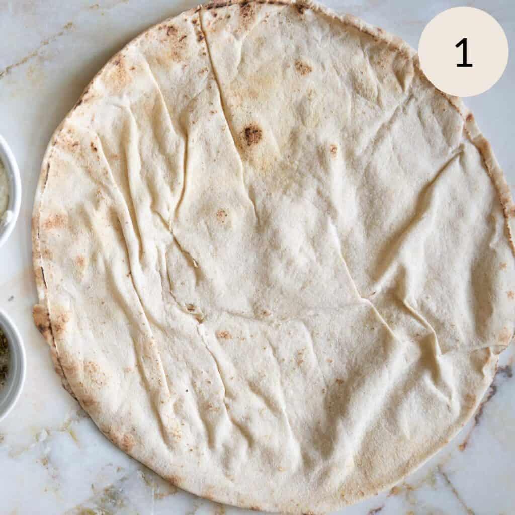 splitting the Lebanese pita bread