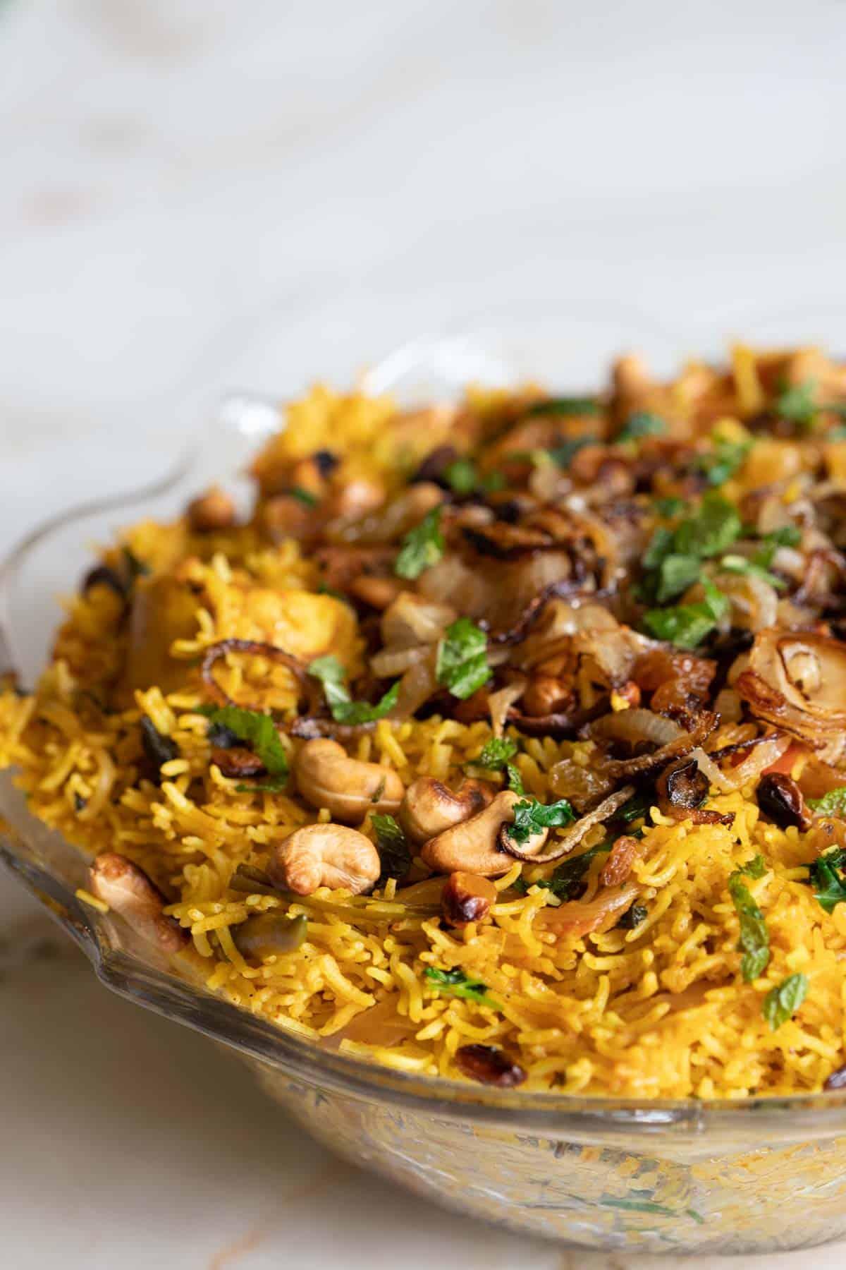 chicken biryani rice in a clear bowl