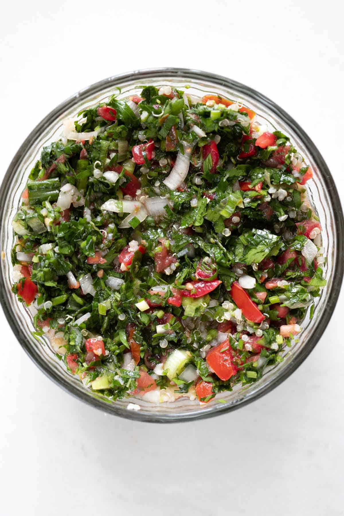 quinoa tabbouleh in a glass bowl
