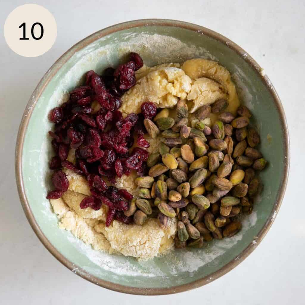 add the dried cranberries and pistachios to the biscotti dough