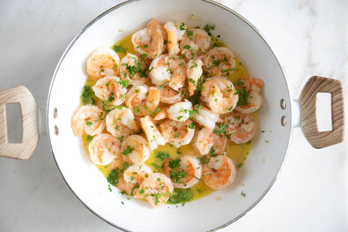 add some chopped parsley to the sautéed shrimp after it has been cooked