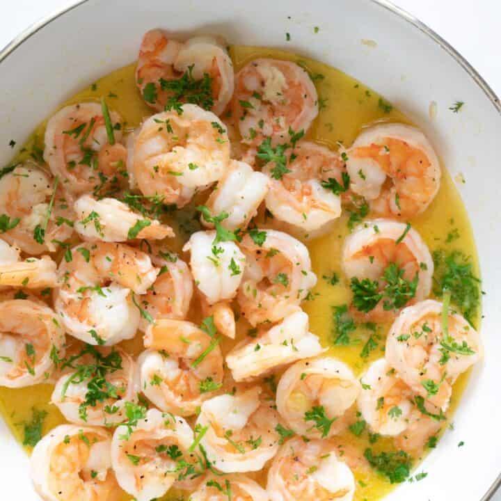 a close up view of sautéed lemon garlic butter shrimp