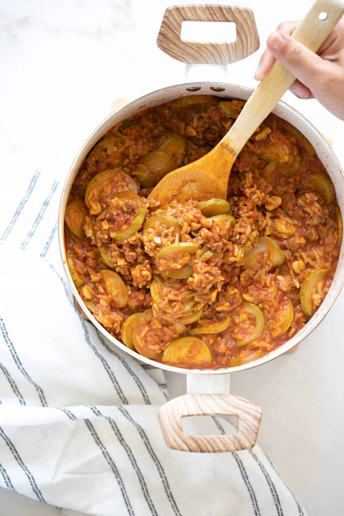 squash and rice casserole with minced meat in a pot