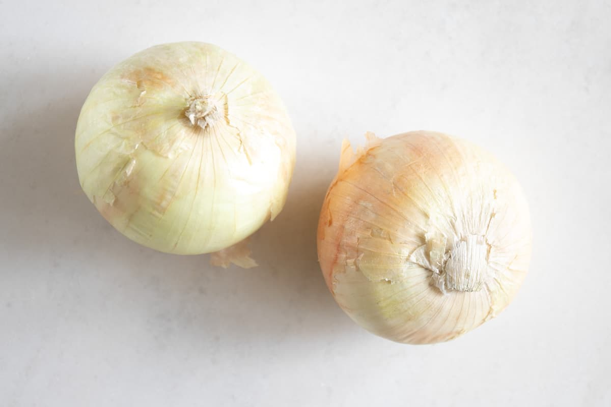 two whole white onions