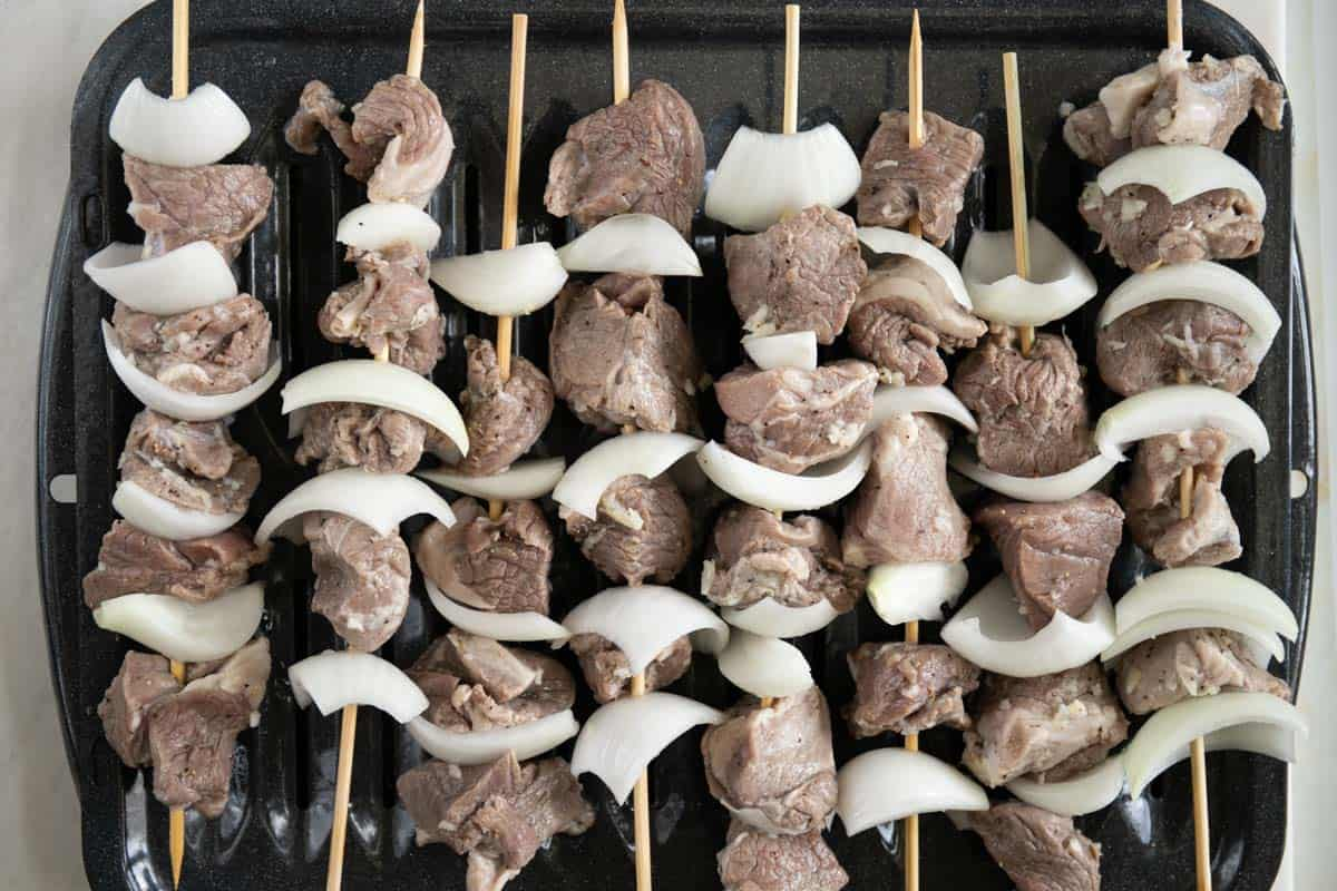 lamb kabobs on a baking tray prior to going into the oven