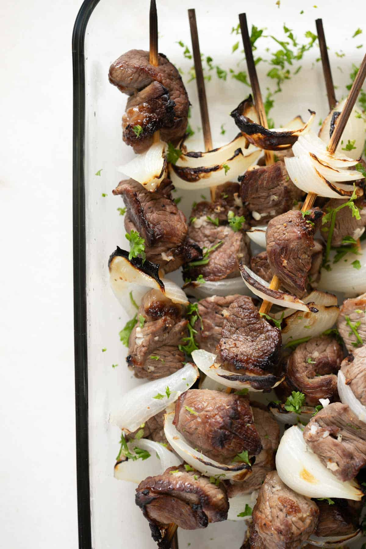 lamb kabob skewers with roasted onion wedges