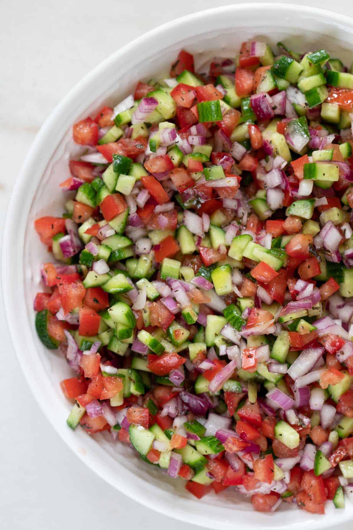 Shirazi salad in a white bowl