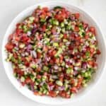 Persian salad in a white bowl