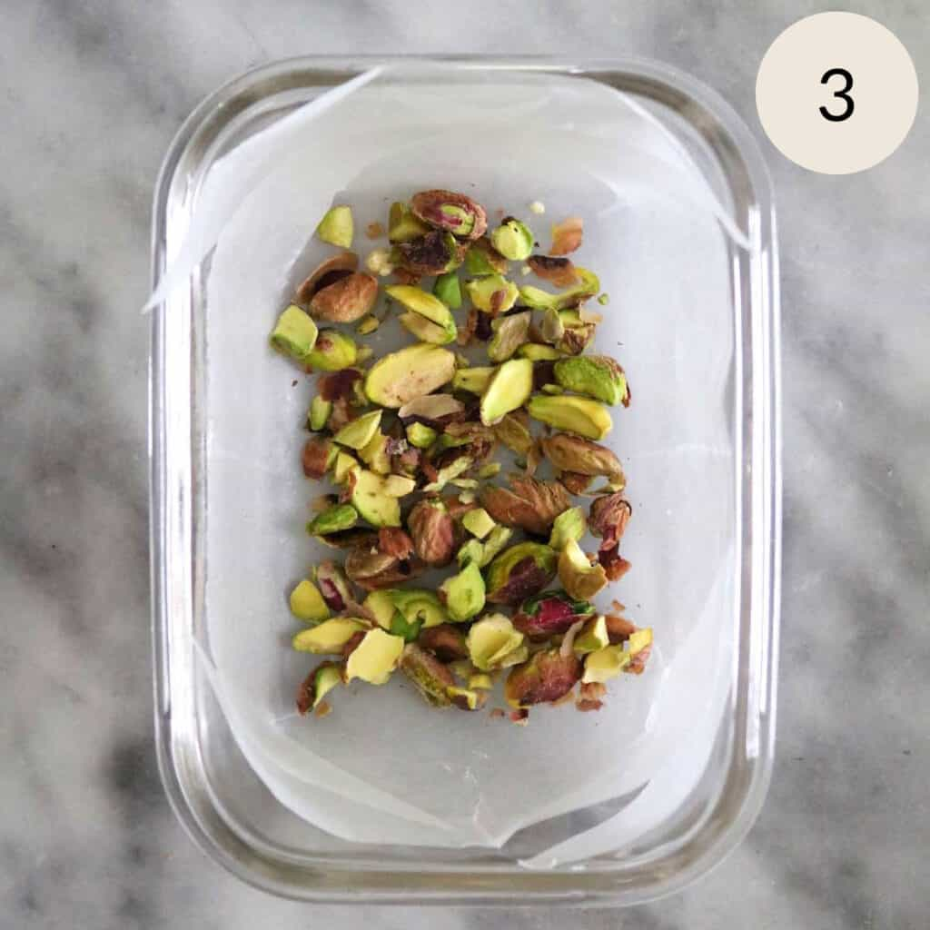 layer the chopped pistachios on parchment paper in the glass container